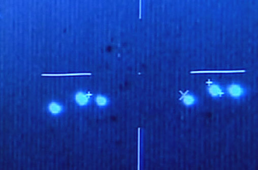 1.Image made from a video shows unidentified flying objects in  the skies over southern Campeche state filmed by Mexican Air Force  pilots, in 2004. The tape shows the bright objects, some sharp points of  light and others like large headlights, moving rapidly in what appears  to be a late-evening sky.